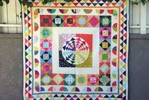 Medallion Quilts / Examples of quilts that are made up of rows constructed around a central patchwork block.