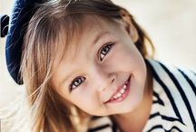 Smiles / A smile is so powerful it can change the mood of a group of people without a word. - Lee Wilcox