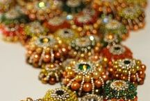 Beadalicious / Beads in jewelry, doll clothing, and more. Beaded necklaces, bracelets, earrings, rings, by amazingly talented artists.