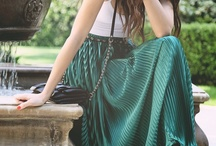Pleated skirts worn with styles