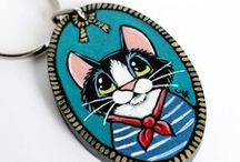 Cute Kitty Gifts for Cat Lovers / The purrfect collection of gift ideas for cat owners and cat enthusiasts. From mugs and pillows, to original artwork, phone cases and greeting cards, these kitties will make anyone purr with delight!