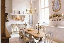kitchen love / creates a more open, spacious and airy feeling, allowing for more windows; must have a good plan for storage, ie good pantry and lower cabinet design