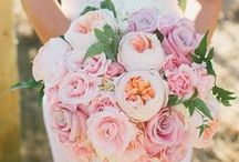 Bouquets / Here's a tip from Colin Cowie: Carry your bouquet low as you walk down the aisle to appear longer & leaner.