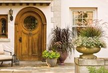 Front Doors / Feeling crafty? Give your front entrance a whole new look each year using a small can of paint and flowers to match. Even if you're a busy mom with little time to garden, decorating your front porch to create a beautiful first impression and boost curb appeal can be done as a simple weekend DIY home improvement project.