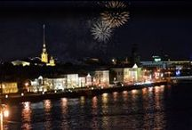 St Petersburg, Russia at Night / The city of St Petersburg in Russia illuminates the Neva River at night.