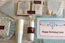 Boys 1st birthday party ideas / •Paper Eskimo, Illume Design and Sambellina - Boys christening and 1st birthday themed party invitations and matching thank you tags  •Paper Eskimo Powder blue and Pastel blue tablesettings and decorations, cupcake stands and candles •Mini milk bottles and pale blue striped runners for christening tables, 1st birthday and lolly buffet ideas •Boys 1st birthday party supplies and party favour ideas