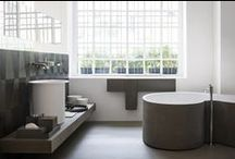 "DR bath tube - Agape / ""A bathtub for two users, thought for socializing, in accordance with the new way of living and sharing the bathroom: DR establishes the collaboration between Agape and the Brasilian studio MK27 and is designed as big basin of a sinuous shape that welcomes the body in a natural, relaxing and friendly manner"". Launched during the Fuorisalone 2014 in Milan, this year the DR bathtube was presented with a new raw earth coating signed by Matteo Brioni srl."