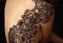 tattoos / by Corinne Thompson