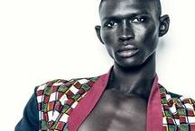 """Models - Fernando Cabral / Portuguese, born in Guinea-Bissau.6'2"""" Brown hair and eyes. Gorgeous skin. He is the younger brother of Armando Cabral, former model who now has a shoe line, and first modeled with him for H&M 2012. Fernando has overtaken his brother and many other models. He is among the few who can walk or be photographed in anything and imbue it with his work-of-art visual persona. His editorials are graphically stunning, as is his in-demand runway presence. He would love to travel in space."""