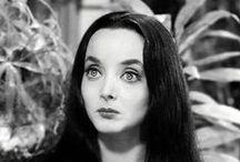 Morticia Addams / The glamorous goddess of gorgeously grim elegance.