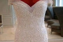 Wedding DRESS ideas. / by Katie Gates