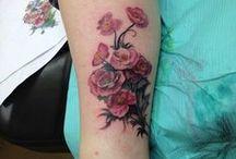 Tattoos and Piercings / by Nicole Machalk