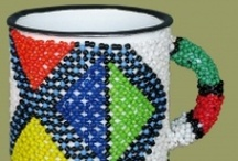 Beaded Tin Mugs / Beaded Tin Mugs hand made in South Africa from enamel mugs and African beads. Beaded tin mugs are available in a wide range of colors and African patterns.