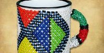 African Beaded Tin Mugs / African Beaded tin mugs handmade in the rural areas of South Africa using enamel tin mugs and African beadwork. Beaded tin mugs are available in a wide range of colors and African patterns.