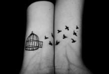 Tattoos / by Shannon Poirier
