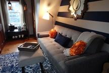 Megan's Rooms / Mid-century modern, navy, orange, brown, tweed sofa, starburst mirror, coffee bar,  / by Gloria McMahon