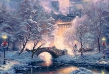 "Kinkadian / Paintings by Thomas Kinkade in his most well known and beloved style, coined ""Kinkadian"" for it's unique use of light and the ability to capture slices of life when times were simpler and less rushed.  The glow of hearth and home are often found, beckoning you inside to stay awhile and enjoy the warm conversation of those you love."