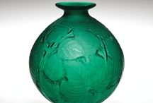 Green Glass / Glass is colored by adding different metallic compounds to the batch. Iron is most often used to color glass green. See green glass in the Museum's collection, from antiquity to present.