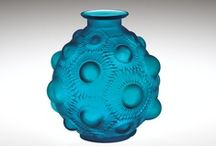 Blue Glass / Glass is colored by adding different metallic compounds to the batch. Cobalt is most often used to color glass blue. See blue glass in the Museum's collection, from antiquity to present.