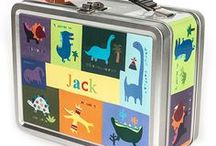Personalized Lunchboxes / Our personalized lunch boxes make your child feel special every day! Each one of our lunch boxes features your child's name on multiple sides. On the inside lid, there's a chalkboard where you can write a personalized note to your child each morning!  Safe for storing food, our lunch boxes are made of tin and contain no lead. They're also great for storing toys and other treasures!