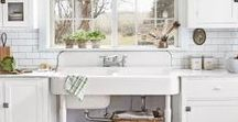 In My Kitchen. / Light-filled, vintage-inspired kitchens...worn wood floors, farmhouse sinks and tables, subway tiles, open shelving, brightly patterned throw rugs, and modern appliances with a vintage vibe.