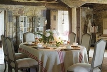 Style - European / Crusty finishes, old beams, armoires, French chairs, stone floors, antique terra cotta, plaster, gutsy hinges, copper pots, olive jars, grey wash, (tiny applicances :-), weathered tables, linen, tapestries.