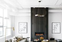 Black Fireplaces / Black fireplaces make a statement, whether they are black marble, stained wood, painted wood, special tiles, etc. Black is back!