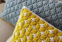 NEEDLEPOINT / Needlepoint is a form of counted thread embroidery in which yarn is stitched through a stiff open weave canvas. Most needlepoint designs completely cover the canvas.