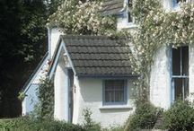 whitewashed cottage by the sea