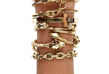 fashion: bracelets / jewelry, stacks of bracelets and rings