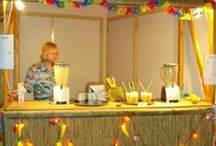 Vers Fruit Cocktail Bar / 2 shakers serveren vers fruit cocktails/ smoothies vanuit een tropische rieten bar bij u op locatie.