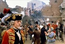 Baron Munchausen / The Adventures of Baron Munchausen is a 1989 British adventure fantasy comedy film written and directed by Terry Gilliam, starring John Neville, Sarah Polley, Eric Idle, Jonathan Pryce, Oliver Reed, Uma Thurman and Robin Williams. Based on the outrageous tall tales that the 18th-century German nobleman Baron Münchhausen was alleged to have told about his wartime exploits against the Ottoman Empire