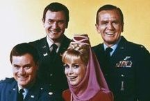 I Dream of Jeannie / I Dream of Jeannie is an American sitcom with a fantasy premise. The show starred Barbara Eden as a 2,000-year-old genie, and Larry Hagman as an astronaut who becomes her master, with whom she falls in love and eventually marries