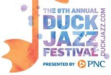 Duck Jazz - Hot Music, Cool Views / The Duck Jazz Festival is a free, non-tickted annual event held in Duck, North Carolina. This premier jazz event is designed to provide a unique entertainment opportunity for residents and visitors on the Outer Banks of North Carolina, and to encourage people to stay in the area and support local businesses. Businesses throughout Duck participate by offering jazz events in conjunction with the festival.