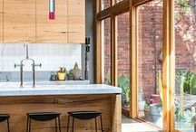 A Delicious Kitchen / Gorgeous, clean kitchen design. Kitchen islands, pendant lights,  eating spaces, open shelving, appliances, rugs and flooring, Plus beautiful culinary tools for the kitchen.