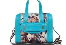Spring 2013 / Spring 2013 is all about make a statement with colors. From our blue island to our neutral beach tan. At the same time we are introducing our new shapes like the Merida over size clutch and the Sunny isle the ideal satchel. Make sure you check out our collection here and our website!