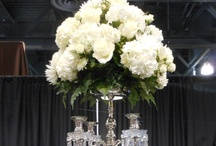 Tablescapes: Platinum Theme  / The classic wedding  theme:  silver bowls filled with roses, lilies and white hydrangeas in ivory or white colors that set the epitome of romantic elegance.