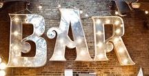 Industrial Chic Weddings / Industrial Weddings are typically found in cities, whether on a rooftop or in a large loft. Metal, rustic wood and string lights are a must and help add a cozy element of warmth while retaining that delightful edgy feel that makes an urban wedding so exciting.