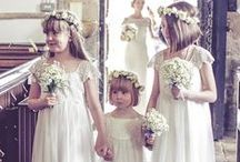 Flower Girl / The flower girl is a young member of the wedding party, walking down the aisle directly before the bride. As she walks, the flower girl may scatter flower petals down the aisle, or she may simply carry a pomander. Her dress usually resembles a smaller version of the bride's wedding dress. Browse the most resourceful ideas and tips about flower girl to find the perfect finishing touches at World of Bridal.