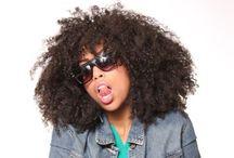 Natural: Medium to long / A pin board with medium to long hairstyles for black natural hair.