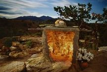 """4-2015 Featured Artists / """"Living Shrines"""" a collection of shrines found throughout New Mexico photographed by Siegfried Halus. And clay sculptures entitled """"Balancing Acts,"""" by Paul Medina."""