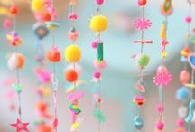 mobiles, pompons...things that hang & dangle