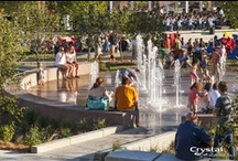Guthrie Green Park - Tulsa Oklahoma / Once a 2.7-acre truck loading facility, Guthrie Green is now an urban garden with interactive fountains, an outdoor stage and a café pavilion. More impressively, Guthrie Green lives up to its name by utilizing the latest in sustainable technology. The entire park is lit by LED lighting, while solar panels on the pavilion roof and a geothermal exchange system help contribute to the energy needs of the park and surrounding area. Crystal provided the water effect and LED products for the fountains / by Crystal Fountains
