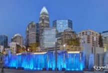 Romare Bearden Park - Charlotte, North Carolina / A 5.4 acre park in the Charlotte city center, Romare Bearden Park is a new public space inspired by the life and work of internationally renowned artist Romare Bearden.  Chief among the park's amenities is a colorful fountain that serves as the centerpiece of the project's Childhood Muse Plaza  The interactive water feature anchors the park's signature space and includes cascading waterfalls and Crystal's LED lighting technology.  / by Crystal Fountains