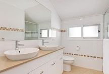 | BATHROOMS | / We specialise in bathroom renovations which must adhere to the Building Code of Australia regulations.  Much like a kitchen, the bathroom is an important and valuable room in your home.  The design is as important as the finishes you choose.  It must be functional and pleasing.