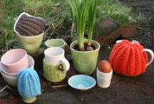 Linda Bloomfield-Ruth Cross cosy collaboration / I make thrown porcelain tableware and collaborate with Ruth Cross who designs hand-knitted cosies to fit my mugs and teapots.