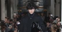 Valentino Men's Fall/Winter 2018-19 Collection / The Fall/Winter 2018-19 Collection breaks the schemes, bringing what is known to unknown territories making it conventional and giving shape to the freedom of being oneself, without labels and belongings. In a play between romanticism and artisto-punk mannerisms, the extraordinary becomes ordinary in a binding sequence of blue, black and grey with unexpected and interior tones of turquoise, dark green, mint green and purple.