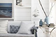 Coastal / Laidback and calming, the Coastal collection heroes pale blues and subtle ticker stripes. Natural textures like washed woods and wicker give depth to the look, while anchor and fish motifs plus porthole mirrors add a little tongue-in-cheek nautical charm. / by Sainsbury's