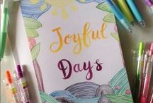 Joyful Days by Cym / 35 pages of calendar, planner inserts, blank lists, cards to personalize and share. Inject positivity Hone gratefulness Set goals and actions Revive connections Personalize and share cards Plan a party List down gifts Most of all, show love and appreciation