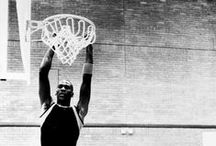 a game called basketball / players dunking and shooting